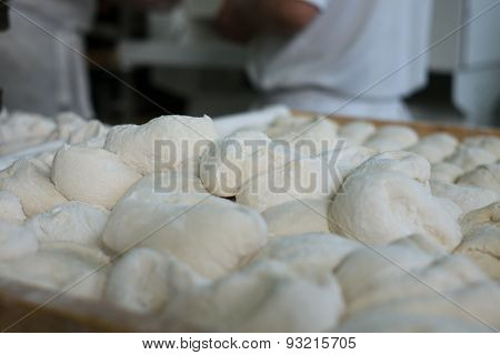 Raw Bread Dough In Front Of Bakers