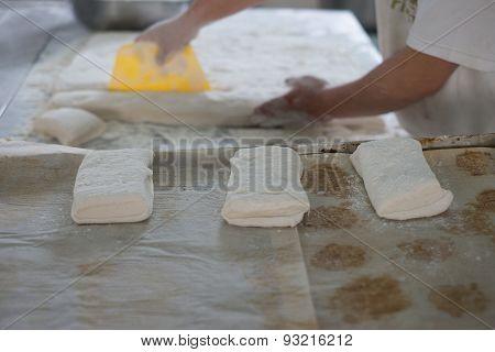 Freshly Made Ciabatta Bread Cut By Baker