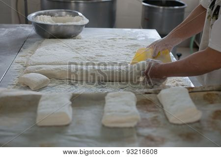 Baker Cutting Raw Ciabatta Bread Dough