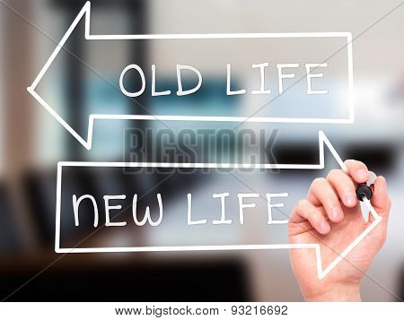 Man hand writing Old Life or New Life on visual screen.