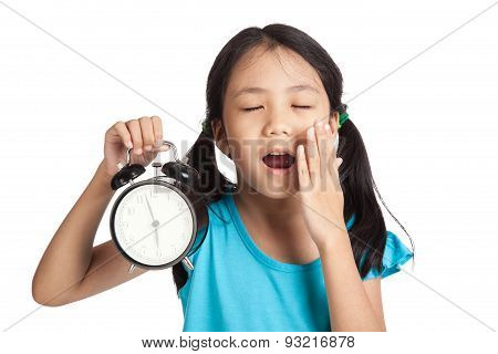 Little Asian Girl Sleepy With A Clock