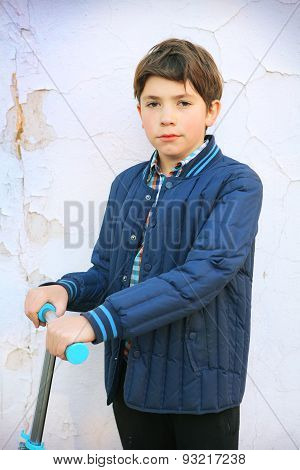 Preteen Handsome Boy Portrait On The White Shabby Wall Background