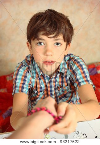 Preteen Hansome Boy Show  The Result Of His Rainbow Loom Hobby Bracelet