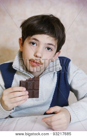 Preteen Handsome Boy Eat Chokolate Bar With Dirty Mouth