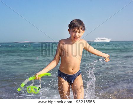 Preteen Handsome Boy With Snorkeling Mask And Tube On The Red Sea Beach And Yaht Background