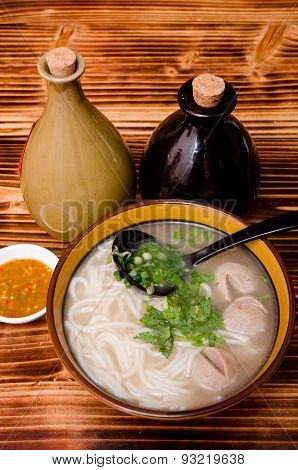 Chinese Wine Noodle In A Bowl With Wine Bottles