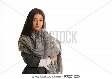 A Girl In A Gray Knitted Scarf Sad.