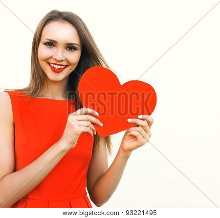 Love, Valentines Day And Beauty Concept - Beautiful Smiling Woman In Red Dress Shows Big Red Paper H