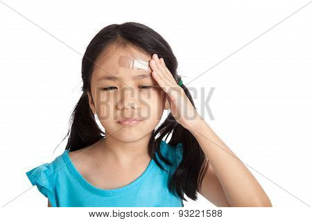Little Asian Girl  With Bandage On Forehead