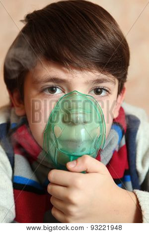 Preteen Boy With Electric Inhaler