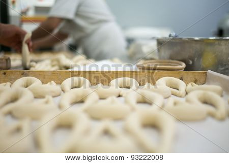 Bakers Preparing Fresh Pretzel Dough On Tray