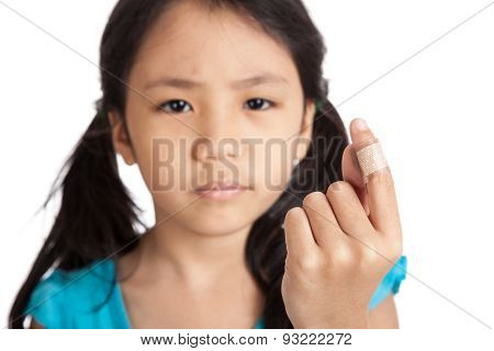 Little Asian Girl Show Finger With Bandage Focus At Bandage