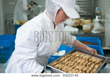 Baker Holding Tray Of Biscotti Cookies