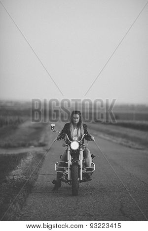 Beautiful woman on the motorcycle.
