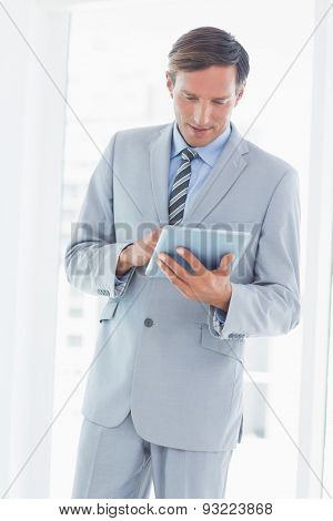 Concentrate businessman using tablet pc in office