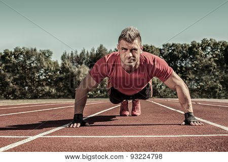 Handsome Young Shirtless Caucasian Fitness Man Doing Push-ups Outdoors On Sunny Summer Day