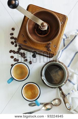 Cups Of Coffee, Coffee Pot And Coffee Grinder. Top View