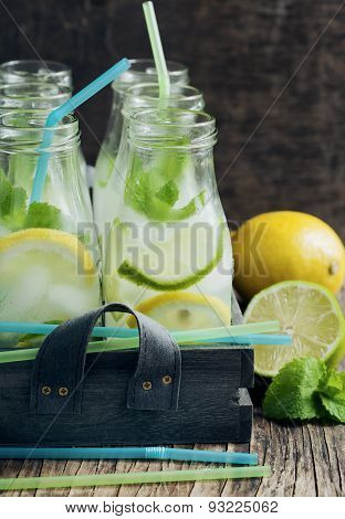 Lemonade In Glass Bottle With Ice And Mint