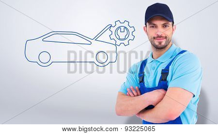 Smiling male handyman in coveralls standing arms crossed against grey vignette
