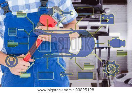 Repairman holding adjustable pliers against auto repair shop