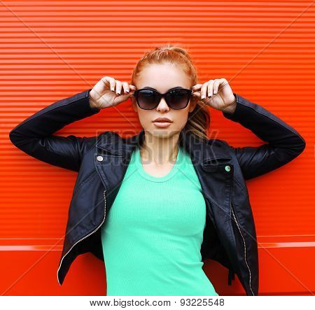 Fashion Portrait Of Pretty Woman In Rock Black Style, Wearing A Sunglasses And Leather Jacket Standi