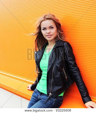 Outdoor Fashion Portrait Of Beautiful Blonde Woman Wearing A Black Rock Leather Jacket In The City