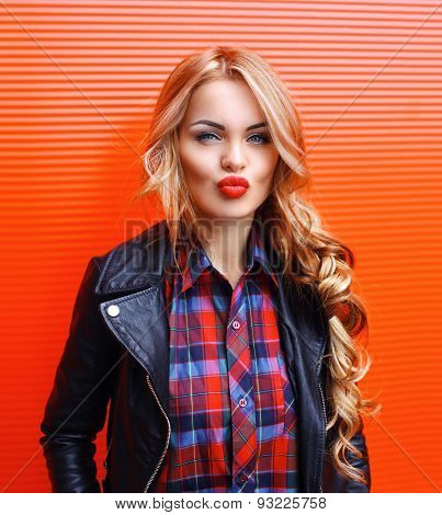 Portrait Of Beautiful Sexy Blonde Woman With Red Lipstick Wearing A Rock Black Style Outdoors In The
