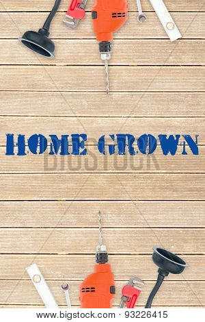 The word home grown against tools on wooden background