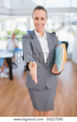 Smiling businesswoman introducing herself in medical office