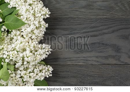 white lilac flower on old oak table top view with copy space