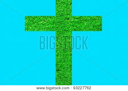 The cross is made of artificial grass.