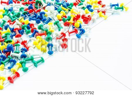 Set of push pins in different colors,isolated on white background.