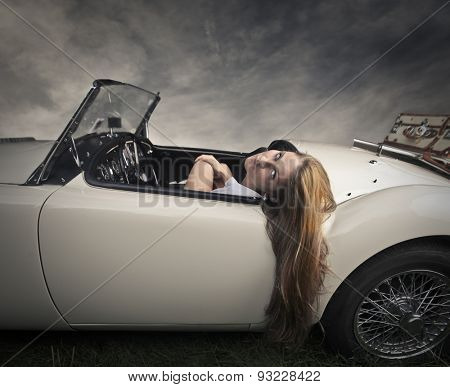 Girl travelling in a posh car