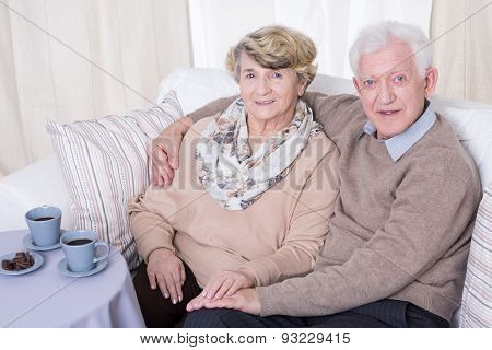 Aged Couple Hugging