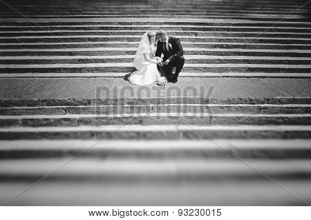 Just Married Couple Sitting On Stairs