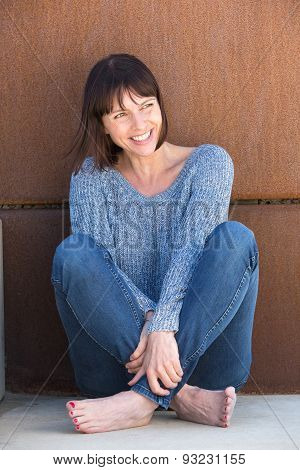 Attractive Older Woman Sitting And Smiling