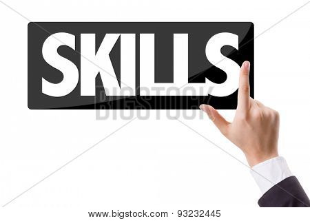 Businessman pressing button with the text: Skills