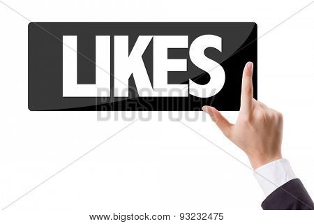 Businessman pressing button with the text: Likes