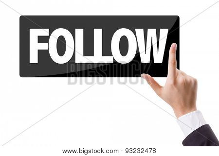 Businessman pressing button with the text: Follow