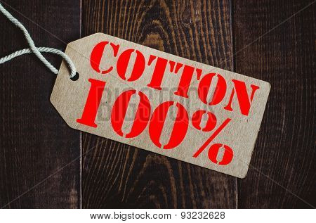 100% cotton.Blank tag on dark wood background