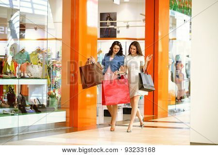 MOSCOW, RUSSIA - CIRCA MAY 2015: Two young girls walk around the store with shopping bags in their hands at Shopping center