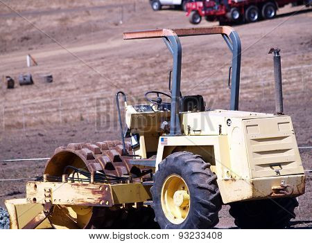 Heavy Earth Moving Equipment Idle In Field
