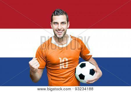 Dutch fan celebrates on Netherlands flag background
