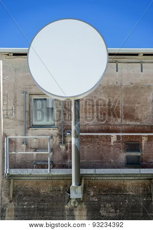 One modern antenna on an old building