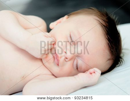 Beautiful baby sleeping the nap in the crib