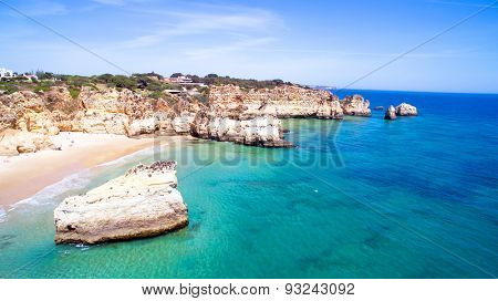 Aerial from natural rocks at Praia Tres Irmaos near Alvor in Portugal