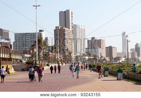 Pedestrians Walking On Beachfront Promenade, Durban South Africa