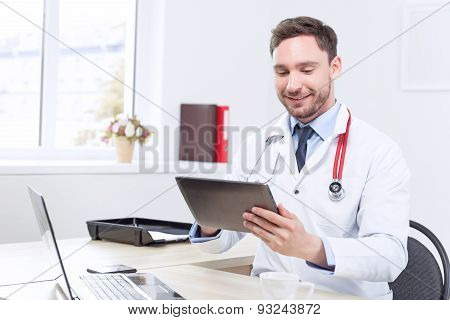 Nice doctor holding the laptop
