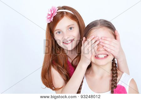 Cheerful girls playing together