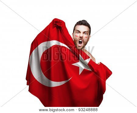 Fan holding the flag of Turkey on white background